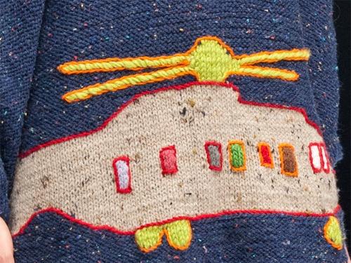 Sweter zrehabilitowany